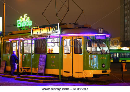 Old tram with Caffe Bimba cafe standing on the Rataje station by night in Poznan, Poland - Stock Photo