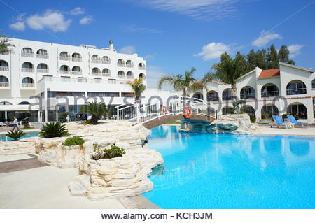 Swimming pool of the four stars Princess Beach hotel on a sunny day in Larnaka, Cyprus - Stock Photo