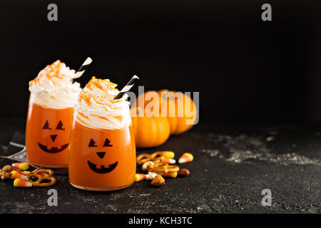 Halloween cold cocktail or drink with jack o'lantern face - Stock Photo