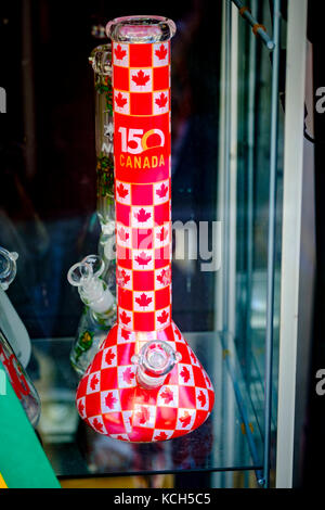 Bong, or water pipe, celebrating Canada's 150 Anniversary on display on the front window of a store in London, Ontario, - Stock Photo