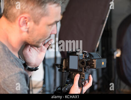 photographer in the process of working in the Studio - Stock Photo