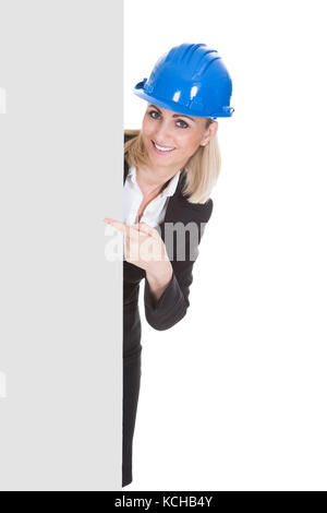 Portrait Of Happy Female Architect Holding Placard Over White Background - Stock Photo