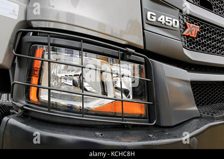 ORIPAA, FINLAND - SEPTEMBER 30, 2017: Detail of headlamp protection and grille of the new Scania XT G450 heavy duty - Stock Photo