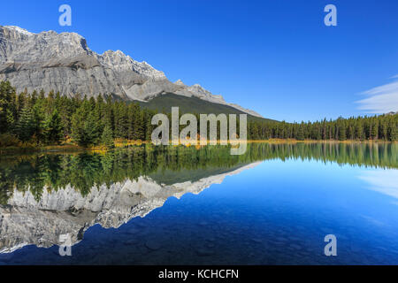 Scenic reflection in Two Jack Lake, Banff National Park, Alberta, Canada - Stock Photo
