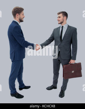 lawyer shaking hands with client welcoming him at the meeting - Stock Photo
