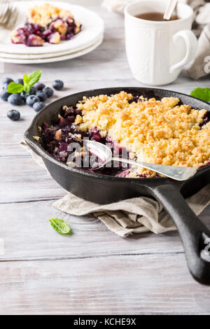 Coconut crumble in cast iron pan - Stock Photo