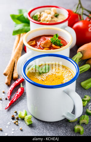 Homemade assorted soups with ingredients - Stock Photo
