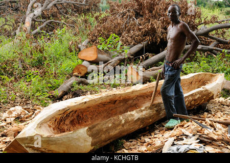 MANDA, TANZANIA - APRIL 22: The native from above the lake Malawi is building traditional boat from one trunk of the tree mango in Tanzania, Manda in