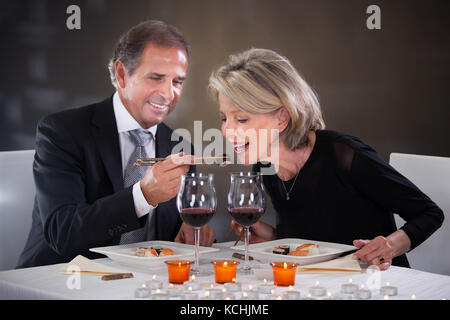 Romantic Mature Couple Having Dinner At Restaurant - Stock Photo
