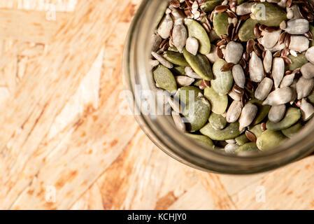 mason jar full of seeds, healthy raw food, mix of flax, sesame, pumpkin and sunflower seeds - Stock Photo