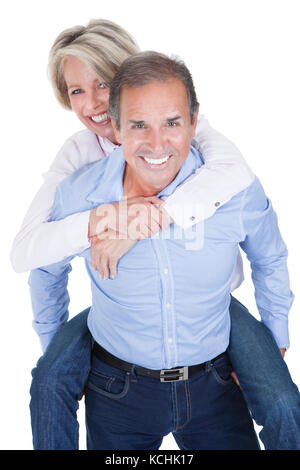 Mature Man Piggybacking His Happy Wife Over White Background - Stock Photo