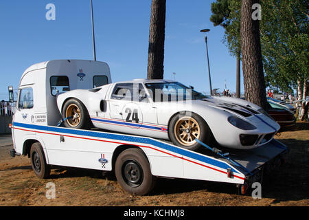 LE MANS, FRANCE, July 8, 2016 : Old racing car being transported to Le Mans Classic on the circuit of the 24 hours. - Stock Photo