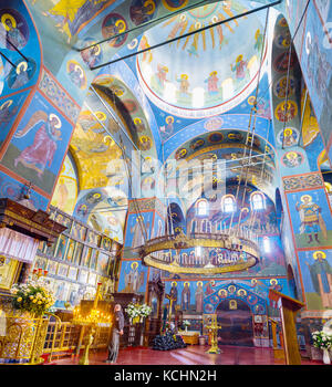POCHAYIV, UKRAINE - AUGUST 30, 2017: Panormic view on Prayer hall of Holy Trinity Cathedral with huge chandelier, - Stock Photo