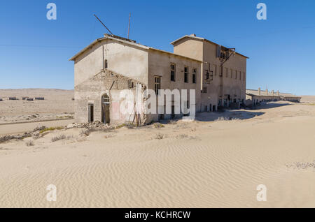 Ruins of once prosperous German mining town Kolmanskop in the Namib desert near Luderitz, Namibia, Southern Africa - Stock Photo