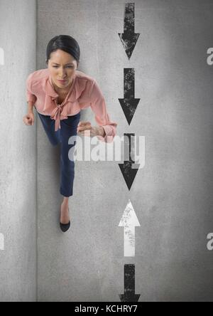Digital composite of Businesswoman walking with arrows in opposite directions - Stock Photo