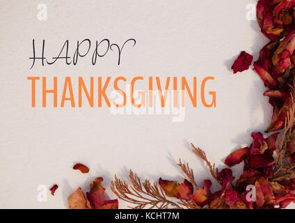 Digital composite of Happy thanksgiving text with dried Autumn flowers - Stock Photo