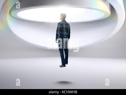 Digital composite of Man being abducted by aliens spacecraft - Stock Photo
