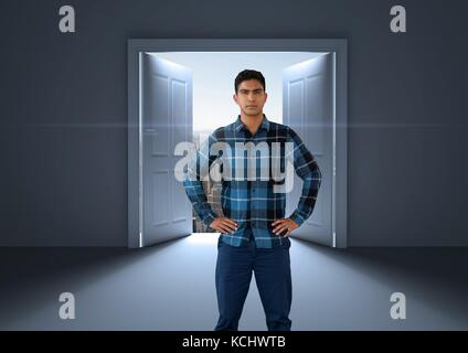 Digital composite of Businessman with hands on hips by open door to city - Stock Photo