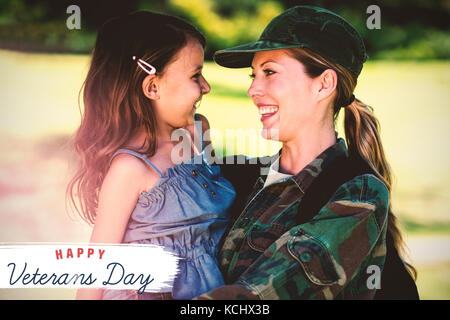 Logo for veterans day in america  against a soldier mother hugging her daughter - Stock Photo