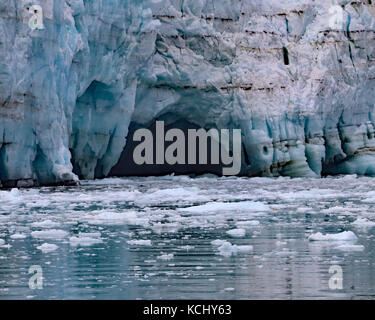 Cavern form as the ice melts on Margerie glacier in Glacier Bay National Park and Preserve, Alaska - Stock Photo