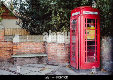 Public telephone box in Wendover converted into a medical centre by using it as a home for a Public Access Defibrillator. - Stock Photo
