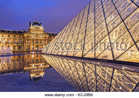 The Louvre in Paris at Night - Stock Photo