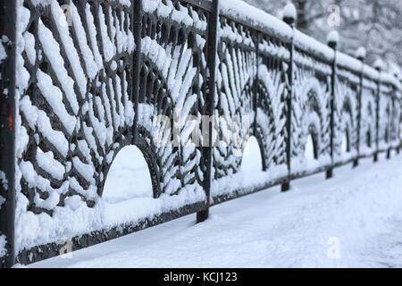 winter wrought fence gates - Stock Photo