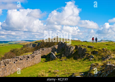 Walkers on Hadrians Wall at Walltown Crags Greenhead Northumberland England UK United Kingdom GB Great Britain - Stock Photo