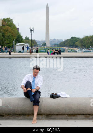 Stephen Colbert, host of the Comedy Central show 'The Colbert Report' puts his sox and shoes back on after working - Stock Photo