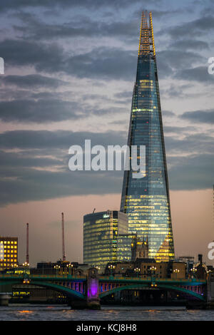 The Shard building in London at sunset - Stock Photo