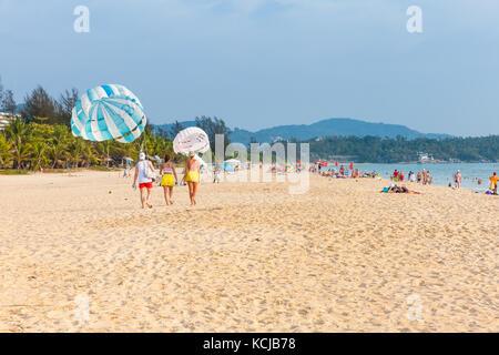 Phuket, Thailand - April 17, 2016: People rest at the Karon Beach on April 17, 2016 in Phuket, Thailand - Stock Photo
