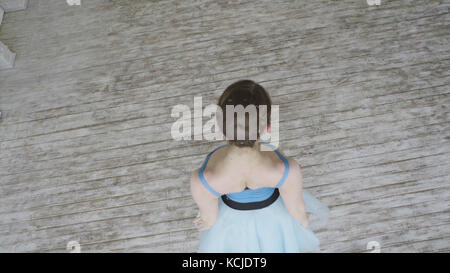 Beautiful Girl Dancer Performs Elements Of Classical Ballet In The Loft Design. Female Ballet Dancer Dancing. Close - Stock Photo