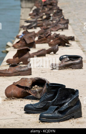 The Shoes on the Danube Bank memorial in Budapest on a sunny day. - Stock Photo