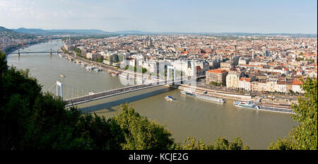 3 picture stitch panoramic cityscape view of the Danube River in Budapest on a sunny day with Elisabeth Bridge foreground - Stock Photo