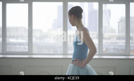 Professional ballet dancer have a rest. Tired ballerina restores breathing and resting. Tired dancer. Female ballerina - Stock Photo