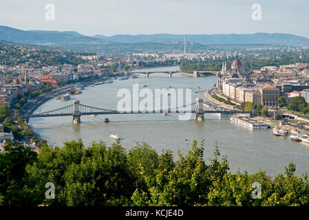 A 3 picture stitch panoramic cityscape view of the Danube river in Budapest on a sunny day and blue sky with the - Stock Photo
