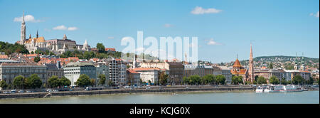 A 3 picture stitch panoramic view of the Buda side of Budapest with The Fisherman's Bastion and Matthias church - Stock Photo