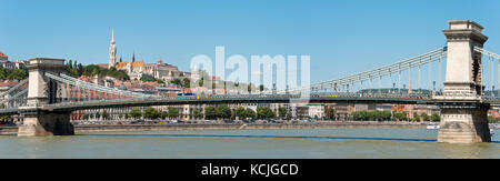 A view of the Széchenyi Chain Bridge across the Danube in Budapest with the Fisherman's Bastion and Matthias Church - Stock Photo