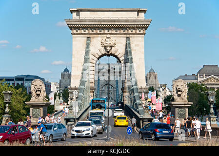 From the Buda side of Budapest a compressed perspective view of tourists, traffic, cars, vehicles entering and leaving - Stock Photo