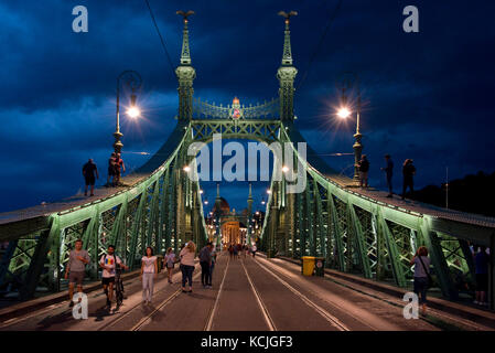 The Liberty Bridge in Budapest is occaisionally closed to all traffice where people can walk and climb on it - sometimes - Stock Photo