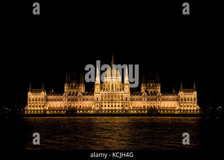 An evening nighttime view of the Hungarian Parliment Building on the Danube river in Budapest. - Stock Photo