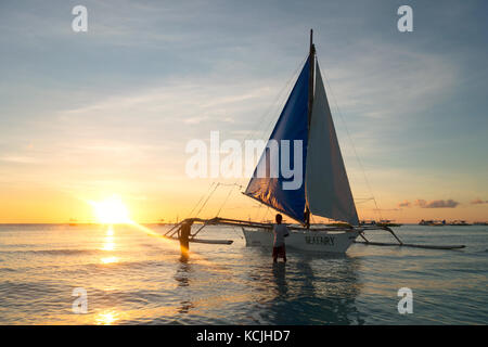 Philippines sunset - a boat on White Beach, Boracay, philippines Asia - Stock Photo