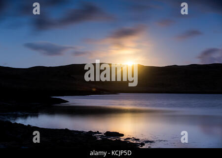 The Full Harvest Moon rising above teifi pools on the Cambrian Mountains in Mid Wales. Credit: Ian Jones/Alamy Live - Stock Photo
