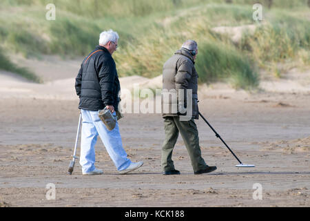 Southport, Merseyside, Sunny in Southport. 6th October 2017. UK Weather.  Keen metal detectorists hunt for hidden - Stock Photo