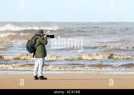 Birdwatching, or birding, birders, wildlife observation binoculars, scopes, optics, tripods at Southport nature - Stock Photo