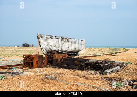 Decaying boat on the beach at Dungeness - Stock Photo