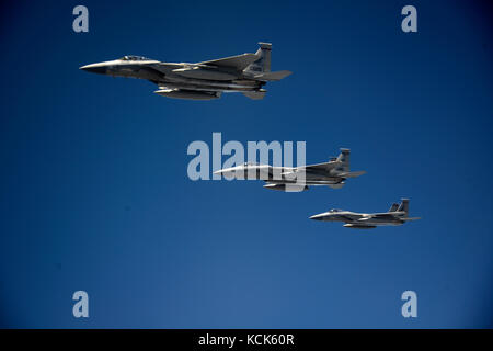 Three U.S. Air Force F-15 Eagle tactical fighter aircraft fly in formation over Kingsley Field during exercise Sentry - Stock Photo
