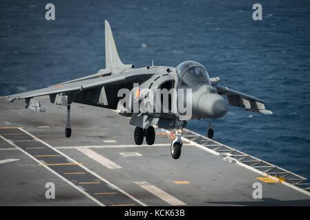 A Spanish Navy AV-8B Harrier II ground-attack aircraft lands on the flight deck aboard the Spanish Navy Juan Carlos - Stock Photo