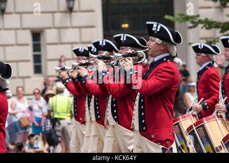 The U.S. Army Old Guard Fife and Drum Corps soldiers perform during the National Independence Day Parade July 4, - Stock Photo