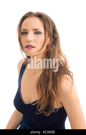 Woman leans forward and her face is doubtful and curious. Female model is wearing a blue velvet dress. Elegance - Stock Photo